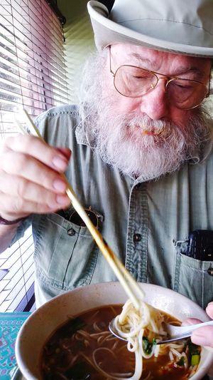 Close-up of man eating food at home