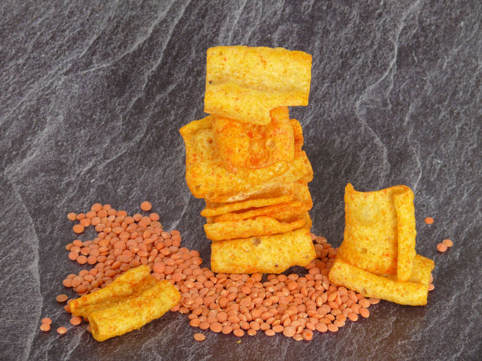 Lentils Chips New Savory Crackers Crackers Nibbles Chilli Proteins Food And Drink Food No People Snack Indoors  Freshness Fast Food Ready-to-eat Close-up Unhealthy Eating Studio Shot Orange Color Fried Yellow French Fries Spice Vegetable Potato Fried Chicken Dinner