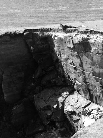 B&w Beauty In Nature Black And White Blackandwhite Cliff Cliffside Clifftop Figure Geology High Looking Down Looking Over The Edge Man Nature Outdoors Outer Hebrides Remote Rock Formation Rocky Scenics Sea Sea And Sky Vertigo Water