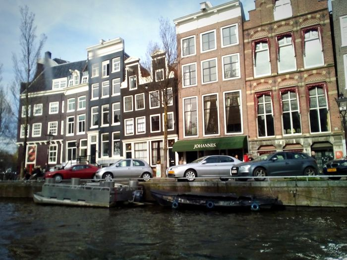 City Water Land Vehicle Car Architecture Building Exterior Sky Built Structure Townhouse Row House Housing Development Dutch Culture Old Town Façade Residential Structure Canal City Street Residential District