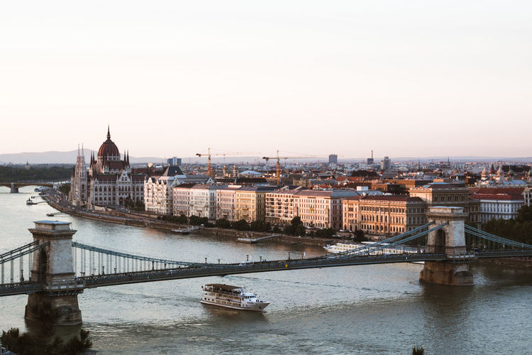 High angle view of szechenyi chain bridge over river in city against sky