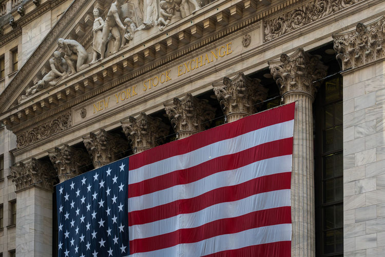 Close-up of the New York stock exchange Architecture Built Structure Low Angle View Building Exterior No People Flag Patriotism Striped Day Building Architectural Column Ornate Wall Street  Wall Street In New York City New York Stock Exchange  NYC New York New York City Close Up