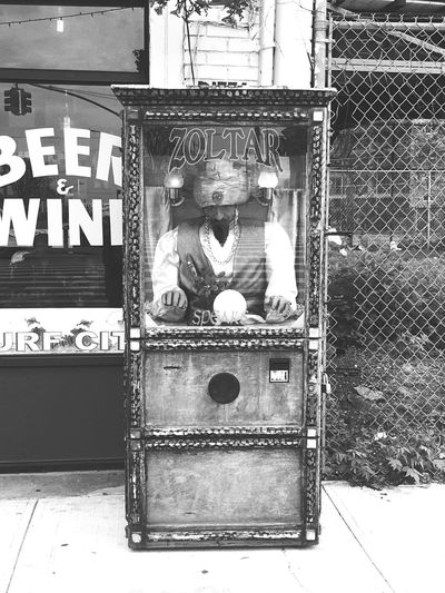 He tells the truth Rami Bdiri USA Coney Island Zoltar Speaks Day No People Architecture Built Structure Outdoors Metal Nature Text Window Street High Angle View Building Exterior Shopping Transportation Wall - Building Feature Glass - Material Box City