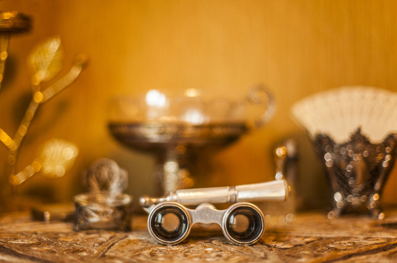 Opera Binoculars Against Antiques On Table