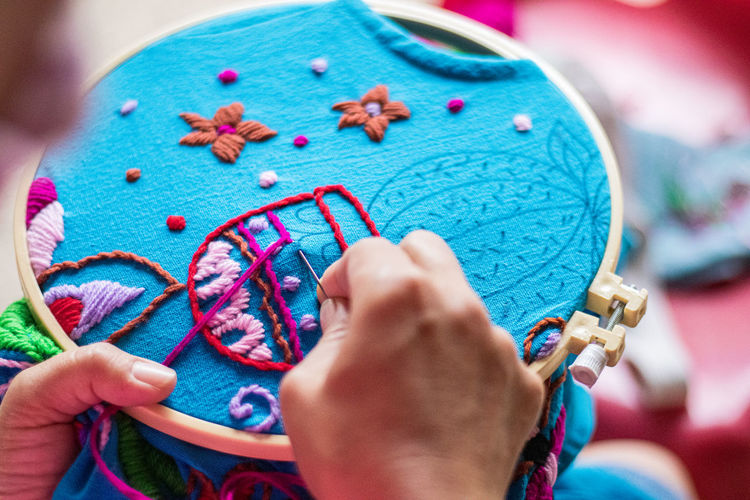 Close-up of hand making embroidery