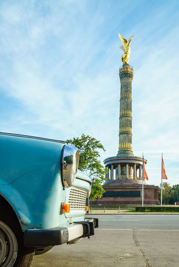 Architecture Built Structure Sky Transportation Land Vehicle Day Mode Of Transportation Travel Nature Motor Vehicle Car No People Travel Destinations Building Exterior City Representation Outdoors Art And Craft Statue Architectural Column Victory Tower Trabant DDR Berlin