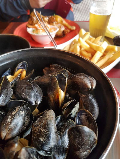 Close-up of mussels and chips traditional belgian food