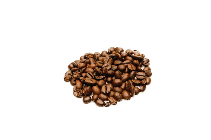 fresh roasted coffee beans isolated on white background Abundance Arabica Brown Caffeine Coffee Coffee Bean Copy Space Directly Above Food And Drink Indoors  Isolated White Background Large Group Of Objects No People Raw Food Roasted Coffee Roasted Coffee Bean Smell Still Life Studio Shot White Background