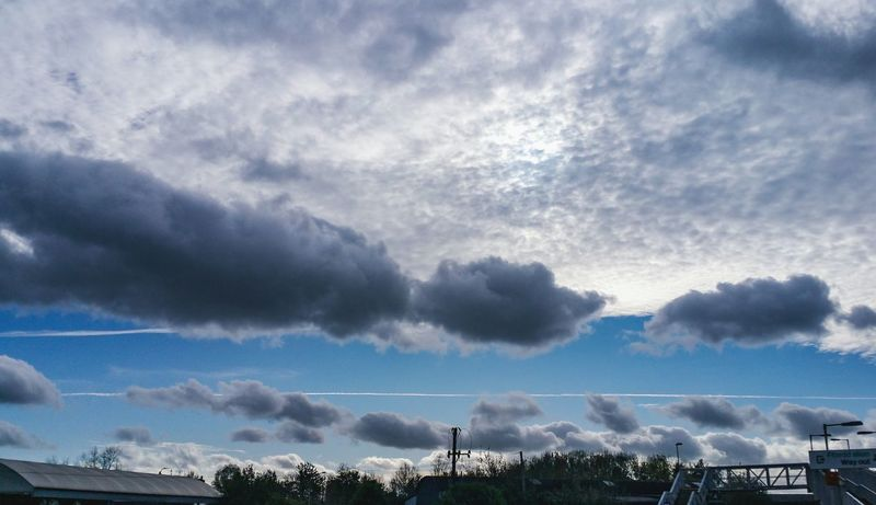Silver Skies over Welshpool Wales UK Clouds Cloudscape Bridge Train Station Contrails Outdoors Sky Cloud - Sky Beauty In Nature Grey Gray Grey Sky Contrail Vapor Trail Autumn Fall Cumulus Day Storm Cloud Nature Looking Up Obscured By Clouds