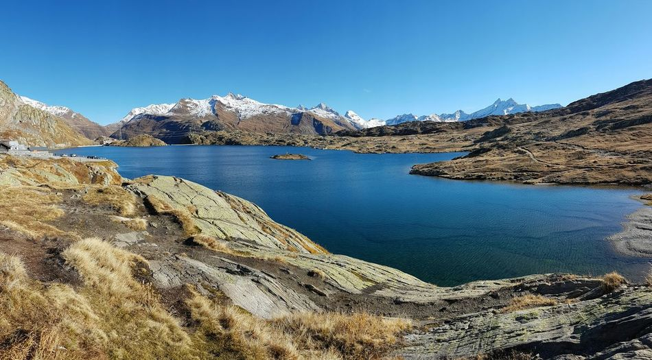 Scenic view of lake and mountains at grimsel pass