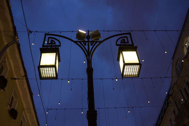 Illuminated built structure against sky