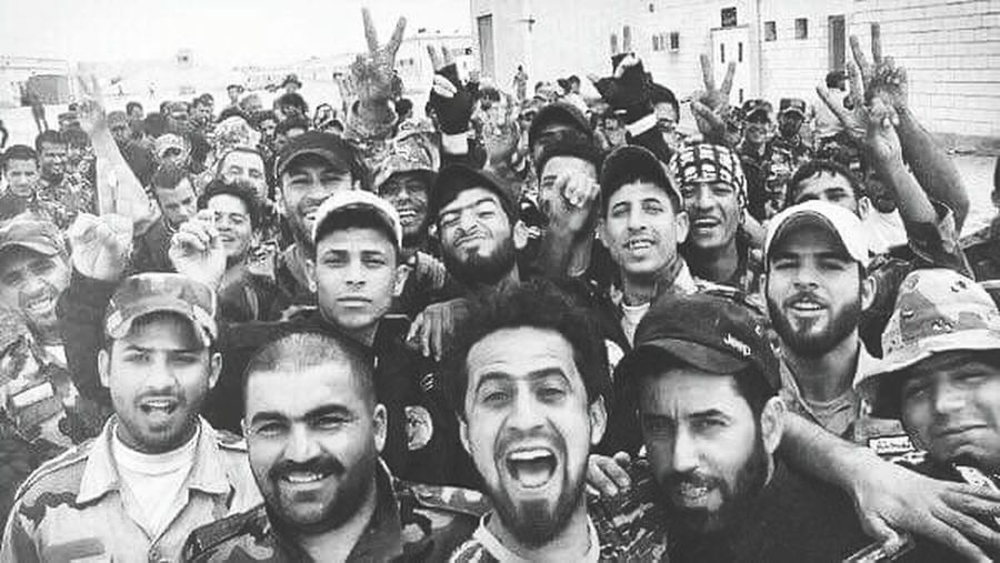 Hey world, are you ready to say bye bye to isis? Check Mosel now ☺✌ Togetherness Leisure Activity Happiness Soldiers Iraq War Iphonephotography Baghdad Focus On Foreground Photographylovers Iraq Religion Whiteandblack Monochrome Photography Tranquil Scene EyeEm Best Shots City Life Photography Selfie ✌ Isis Mosel Victory Building Exterior Famous Place Picoftheday Close-up