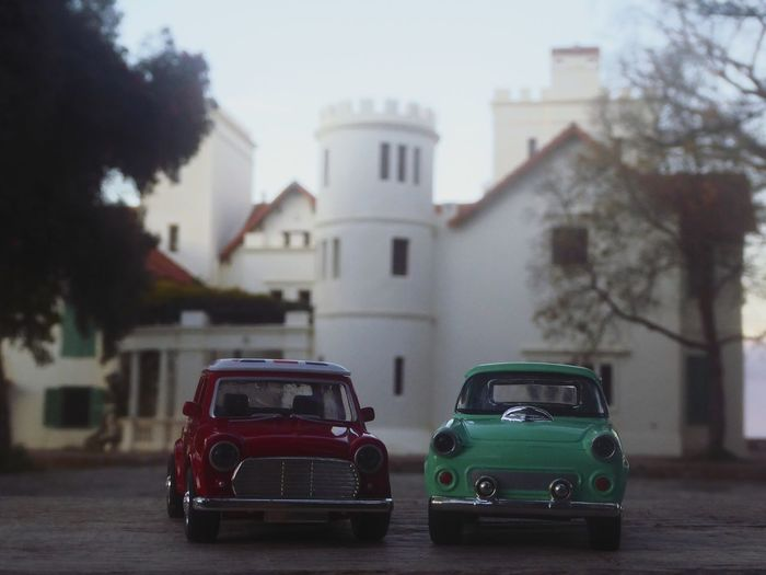 CARS CLASSIC tanger Morocco EyeEm Selects Colour Your Horizn Tanger  Morocco EyeEm Selects London Mini Peugeot Toys Africa Castle Car Sky Transportation Architecture Building Exterior No People Outdoors City Day Built Structure Land Vehicle Mode Of Transport Road Tree