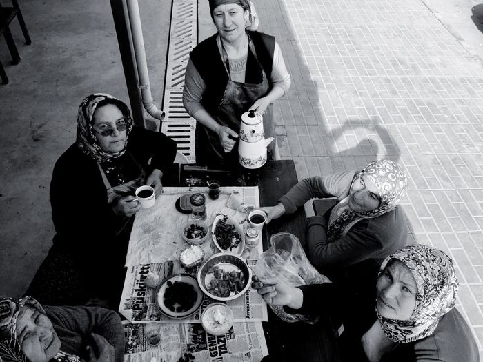Portrait of women having meal at sidewalk cafe