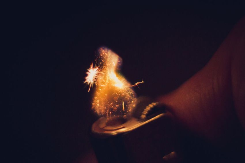 Maximum Closeness Human Hand Holding Burning Flame Sparks Close-up Macro Lighter Fire Illuminated Particle Particles Heat - Temperature