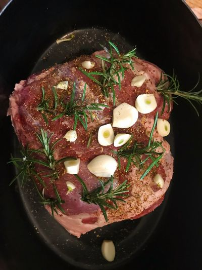 Leg of lamb ready to be cookef Raw Rosemary Garlic Lamb Leg Of Lamb Indoors  Freshness Egg Healthy Eating Directly Above No People