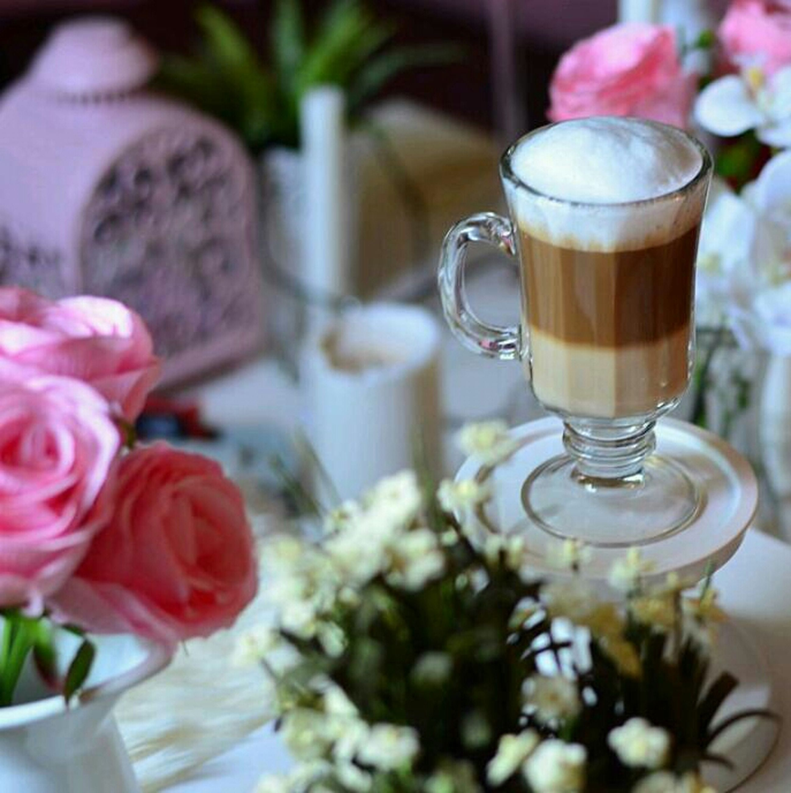 freshness, flower, indoors, drink, food and drink, refreshment, table, close-up, vase, glass - material, petal, saucer, still life, coffee cup, focus on foreground, drinking glass, fragility, cup, coffee - drink, sweet food