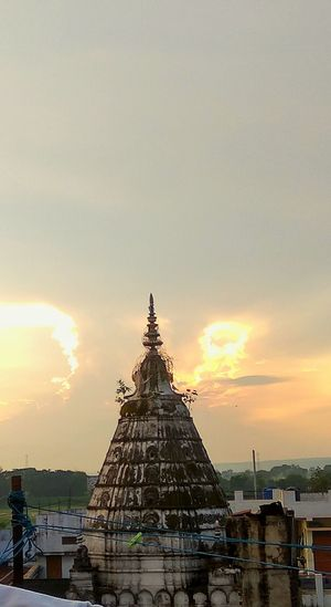 Hometown Clickedwithmobile sky Sunset Sky Built Structure Temple - Building Place Of Worship Cloud Outdoors History Cloud - Sky