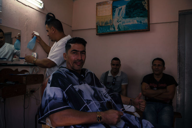 A barber works at his shop in Cienfuegos, Cuba. Barber Barberlife Barbershop Cienfuegos Cienfuegos, Cuba Cuba Cuban Cuban People Frendly Friendship Lifestyles Person Portrait Portrait Photography Travel Traveling