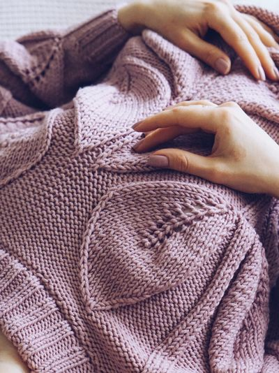 Midsection of woman wearing sweater