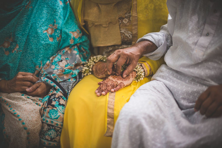 The love of a father Holding Hands Adult Art And Craft Hand Holding Human Body Part Human Hand Midsection People Real People Touching Women Yellow The Portraitist - 2018 EyeEm Awards Love Is Love Be Brave This Is Strength Human Connection Moments Of Happiness #NotYourCliche Love Letter