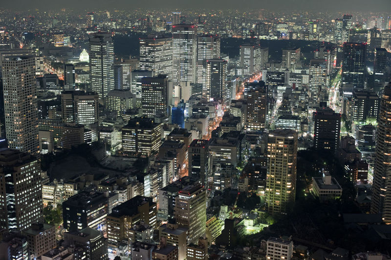 Aerial view of downtown Tokyo buildings and streets at night with illuminated lights Architecture Architecture Building Building Exterior Capital City City Cityscape Cityscape Cityscapemodern Contemporary Destination Evening Far East High-Rise Illuminated Japan Japanese  Modern Night Nippon Office Building Skyscraper Skyscrapers Urban