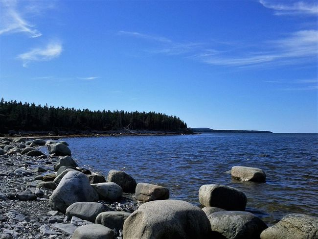Blue Sky Tranquility Tranquil Scene Sea No People Nature Water Beauty In Nature Outdoors Scenics Tree Beach Day Tourism Vacations Anticosti Islands Rocky Rocks Rocks And Water