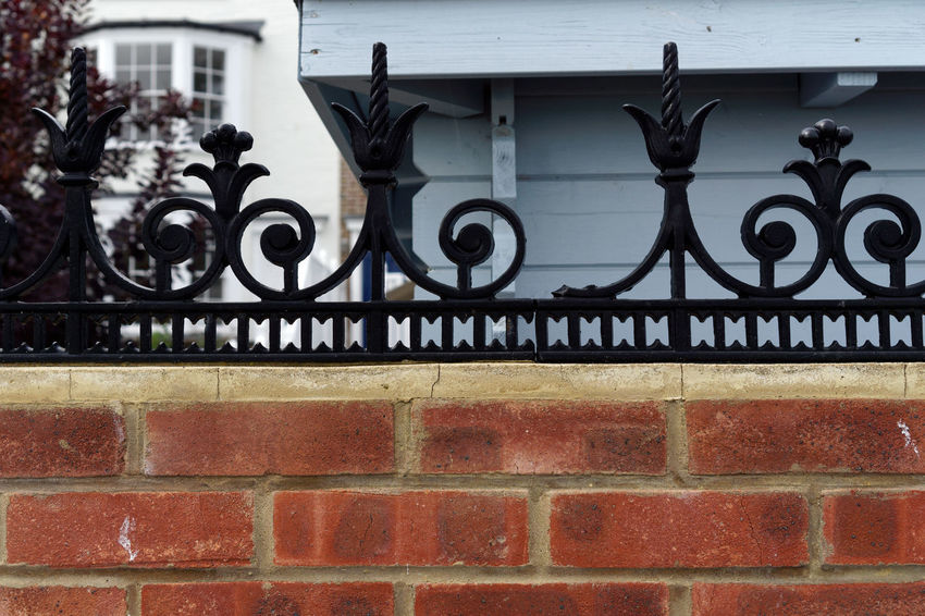 Cool Britannia Posh Red Architecture Blue Brick Wall Building Exterior Built Structure Close-up Day Metal No People Outdoors Privacy Property Protection Safety Security White Wrought Iron