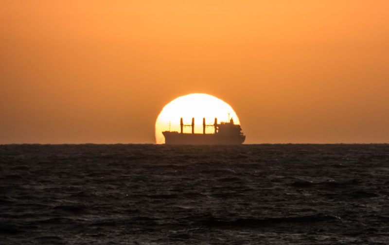 Sunset silhouetting a ship near Freemantle, Western Australia Silhouette Beauty In Nature Freemantle Horizon Horizon Over Water Nature Orange Color Outdoors Sea Sea And Sky Ship Sky Sunset