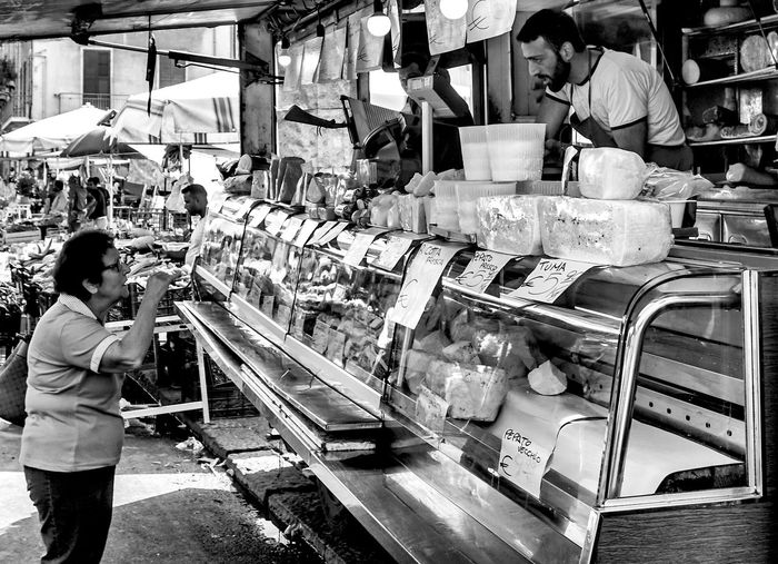 interaction, Palermo, Sicily, Italy Retail  Market Food And Drink Food Shopping Black And White Streetphotography Street Photography Retail Display Palermo Sicily Cheese