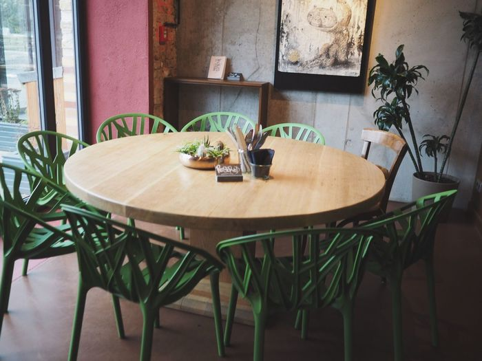 Table Chair Empty No People Plant Indoors  Seat Plate Dining Table Architecture Day Nature Interior Design Interior Green Chair Green Chairs Greenery Plastic Chair Green Odd One Out Loner