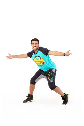 White Background Studio Shot Cut Out One Person Young Adult Sport Lifestyles Smiling Casual Clothing Happiness Shorts Excitement Zumba Fitness Zumba Gym Athletic Fit Dancing Dance Latio Pose Gesturing