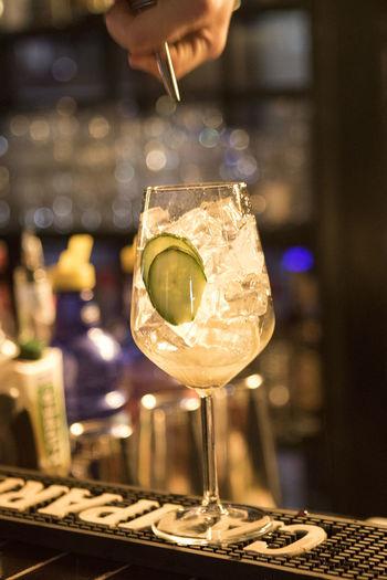 Cropped image of bar tender making cocktail