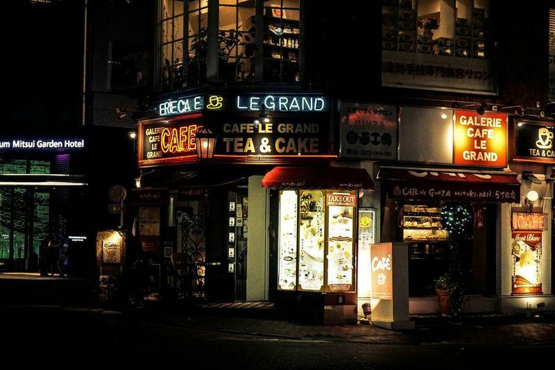Illuminated Cafe Coffee Outdoors Building Exterior Citylife ArchitectureTokyo,Japan The Street Photographer - 2017 EyeEm Awards The Architect - 2017 EyeEm Awards The Photojournalist - 2017 EyeEm Awards EyeEmNewHere EyeEm Best Shots