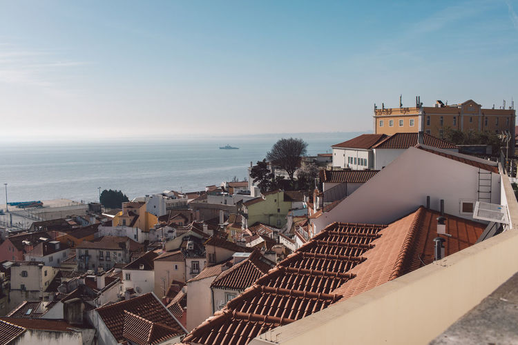 Lisbon Lisboa Lisboa Portugal Lisbon - Portugal Portugal Architecture Built Structure Building Exterior Building Sky City Water Residential District Roof Sea High Angle View Nature House Horizon Over Water Horizon Town Day No People Outdoors Roof Tile TOWNSCAPE
