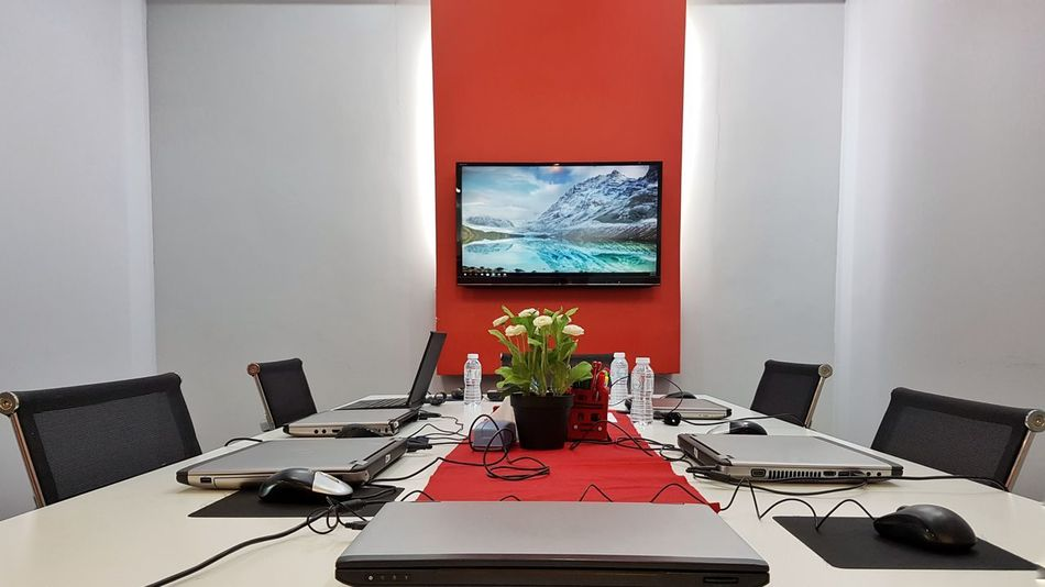 Corporate Training Meeting Room Laptops Computers Technology IT Information Technology Gadgets Peripherals Television Screen Indoors  Table Indoors  Chair No People Neat Day Desk