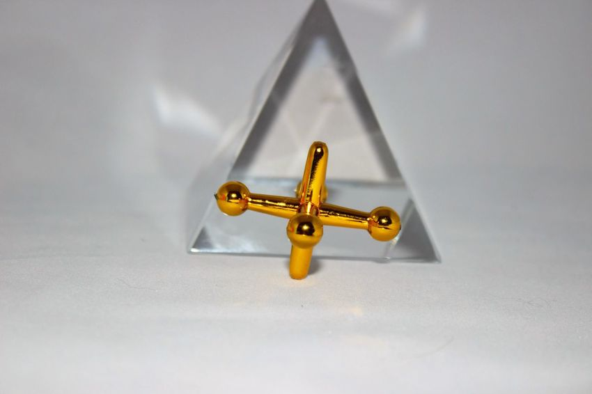 Gold jacks with crystal pyramid Close-up Crystal Clear Day Gold Indoors  Jacks No People Pyramid Toy Photography Toys