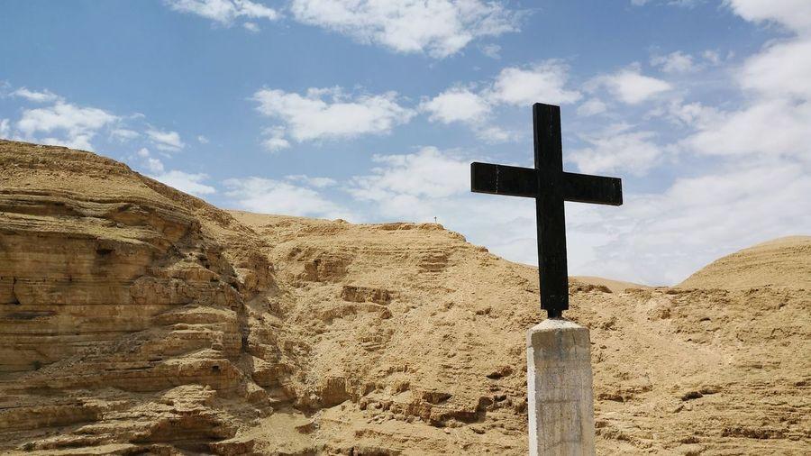 Cross in the Judean desert in Palestine with mountains panorama Judean Desert Religion Religious Symbol Greek Orthodox Orthodox Christianity Wadi Qelt EyeEm Selects Forgiveness Cross Spirituality Religion Symbol Crucifix Sand Sky Cloud - Sky Religious Equipment Civilization Religious Symbol Religious Offering Cross Shape