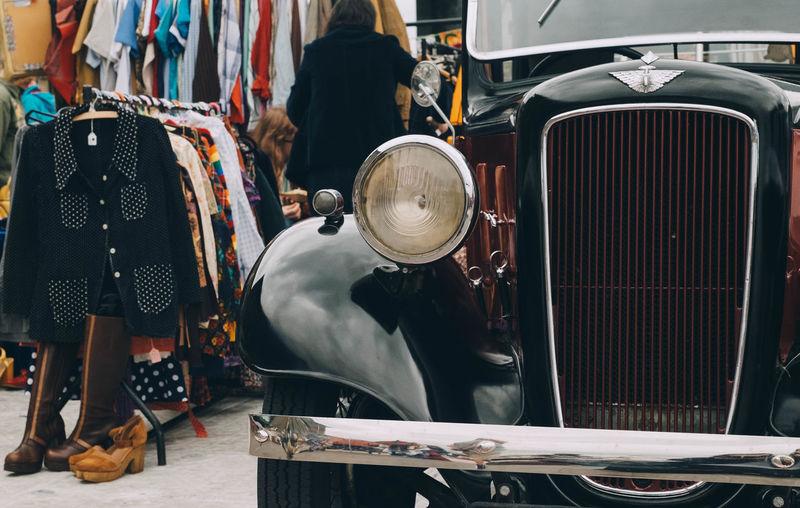 Close-up of vintage car on street in market
