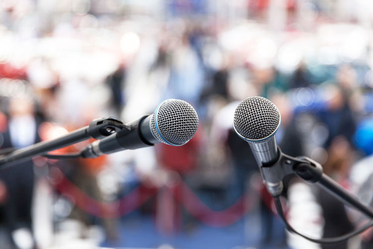 Close up of microphones against crowd
