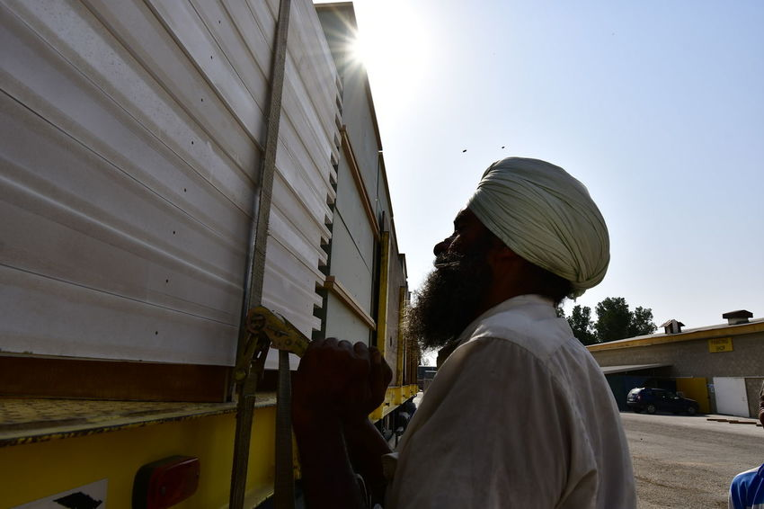 Indian man loading his Truck Beared Style Indian Culture  OneMan Bearded Beardedman Day Indian Man Indian Singer Indian Worker Loading Men One Man Only One Man Only. One Person Real People Singh Man Truck Truck Driver