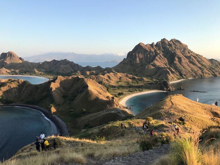 Again Padar EyeEm Selects Mountain Sky Scenics - Nature Water Beauty In Nature Tranquil Scene Mountain Range Tranquility Nature Non-urban Scene Clear Sky Day Idyllic Land Remote Environment Sunlight Lake Landscape Outdoors