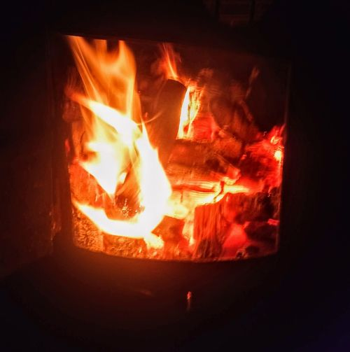 Bonfire Burning Close-up Fire Fire - Natural Phenomenon Fireplace Firewood Flame Glowing Heat - Temperature Indoors  Log Motion Nature Night No People Orange Color Wood Wood - Material Wood Burning Stove