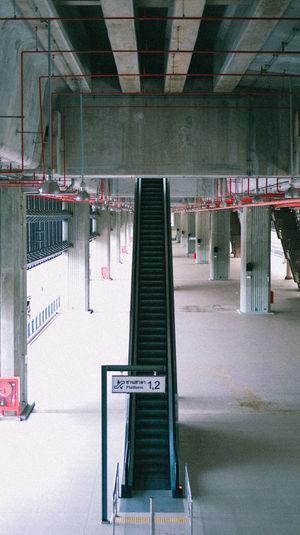 Empty subway station platform in building