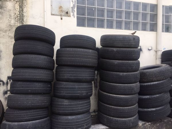 Blocks Bird Stack Tire Large Group Of Objects No People Arrangement Wheel Architecture In A Row Rubber Industry Wall - Building Feature