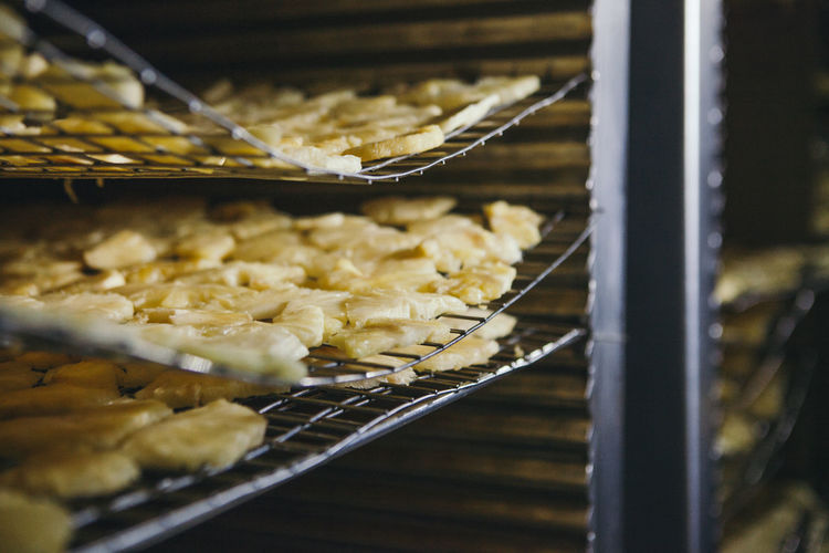 Close-up of pineapple slices on metal grates
