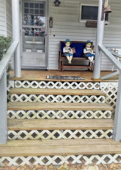 Outdoors Day Front Porch Window Steps Architecture No People Built Structure Lattice Steps Wood Bench Boy And Girl Statuettes Low Angle View Ornate Architectural Column Statue Indoors  Sculpture Scenery