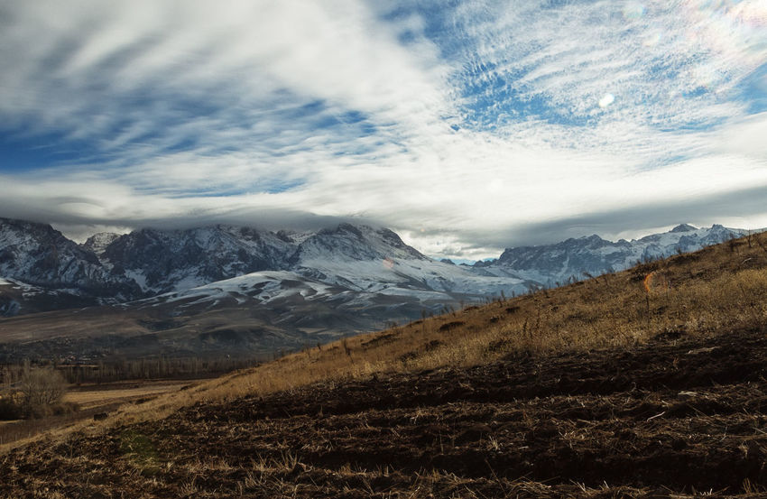 Snowcapped Mountains Beauty In Nature Cloud - Sky Clouds Cold Temperature Fields Grassy Hills And Valleys Hillside Landscape Mountain Range Mountains Mountains And Sky Nature Niğde Outdoors Scenics Sky Snow Snowcapped Mountain Sunbursts Turkey Valleys Wintertime