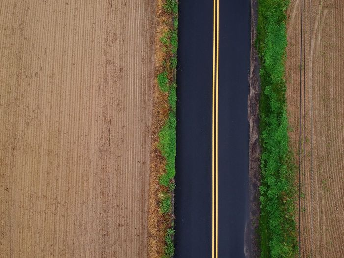 Aerial view of empty road amidst landscape