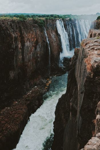 Vic Falls Water Sea Rock Scenics - Nature Nature Beauty In Nature Solid Motion Rock - Object No People Beach Tranquility Day Splashing Rock Formation Waterfall Tranquil Scene Aquatic Sport High Angle View Outdoors